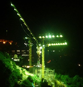 Building site cranes with outdoor security safety lighting