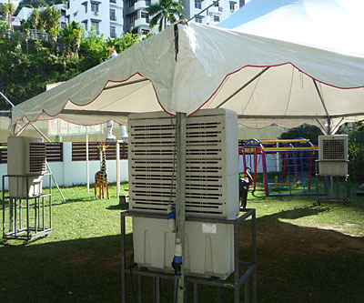 Four huge outdoor air conditioners used for party under marquee or canopy