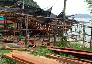 smaller boat under construction, fishing boat, wooden hull and keel