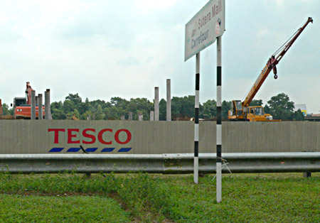Metal fencing around a Tesco building site with sign