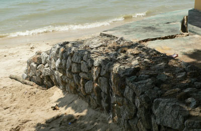 Gabion on beach, wire, rocks 2