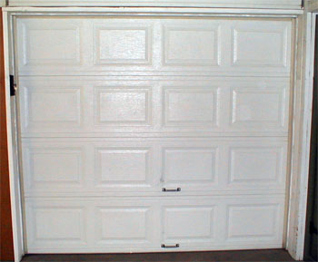 Garage door showing handles at base for manual opening