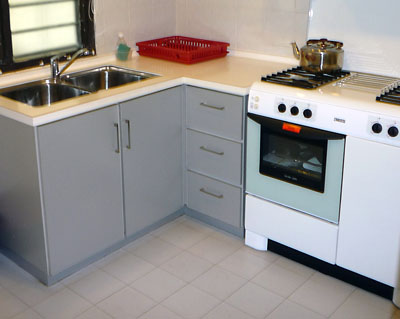 Kitchen laminate worktops and  tiled flooring