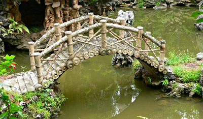 Chinese bridge water feature in garden
